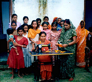 Women learning tailoring skills